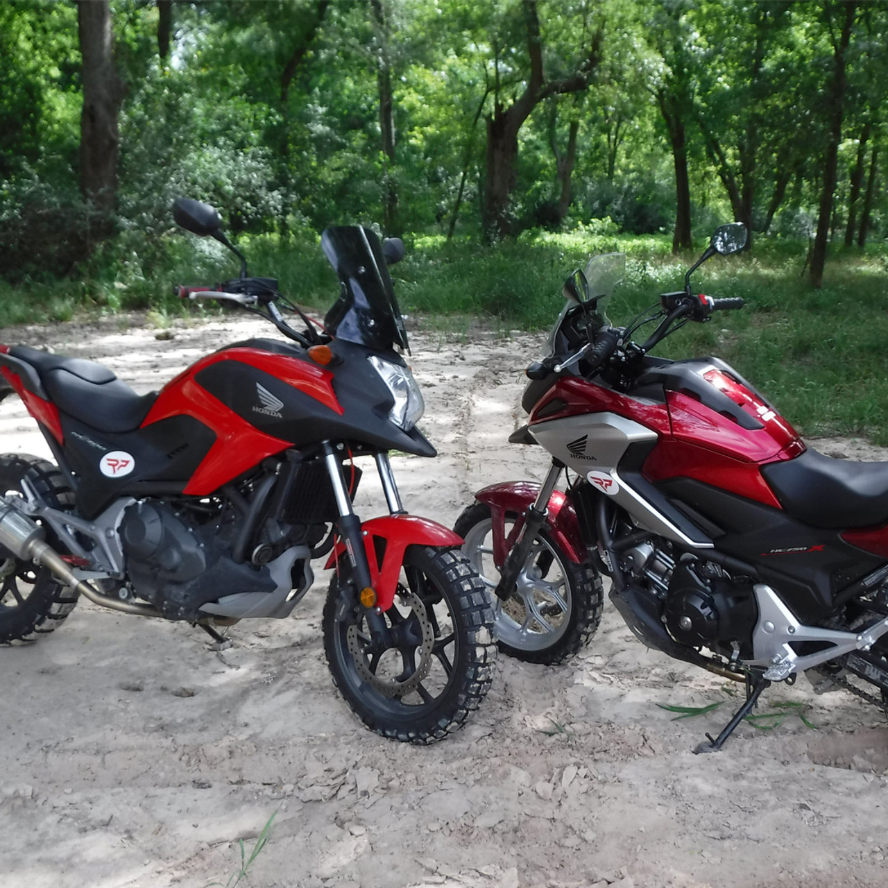 Honda motorcycle modular designed ADV Foot Platforms with wider and more aggressive grips, an angled bottom edge for more clearance, and are available in black, red and brushed aluminum; along with a set of robust pivot mounts that fit most Honda street bikes.