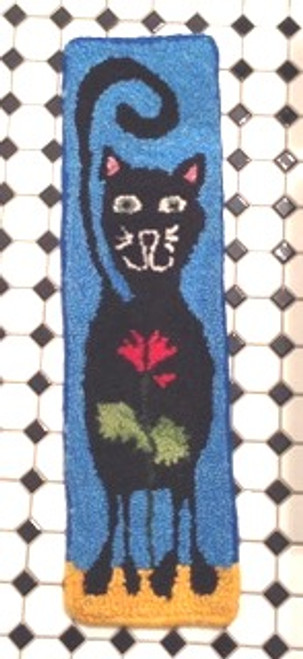 "Punch hooked with  Checkmate Farm wool yarn by Liam a 13 year old boy.  This is his memory rug of ""Fudge"" his cat."