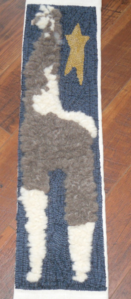 Hooked by Sharon Cochran-Craig.  She used 2 different colors of llama wool and longer loops to add dimension to her project.