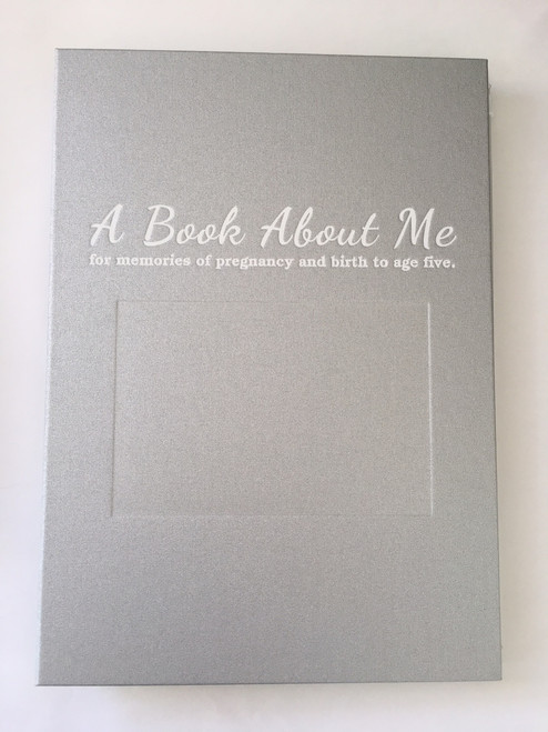 A silver cover for A Book About Me