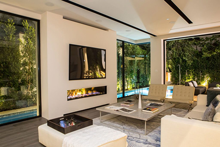 stand-in-awe-of-the-indoor-outdoor-fireplace-to-ul-1024x683.jpg