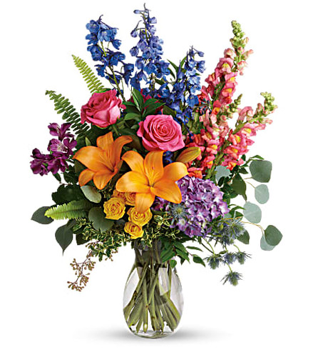 Color any occasion beautiful with this lovely bouquet of hydrangea, roses and lilies in all the colors of the rainbow.