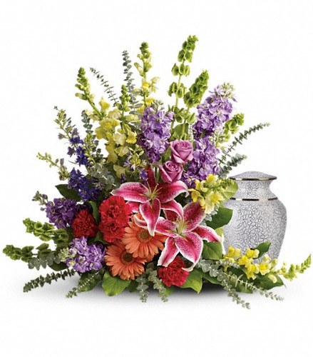 A rainbow of reverence. This uplifting arrangement of lilies, roses and snapdragons is a beautiful reflection of a colorful life well lived.