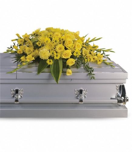 Joyous times and golden memories are recalled with this lovely yellow half-couch casket spray that consoles the bereaved with a sunny array of beautiful blooms.