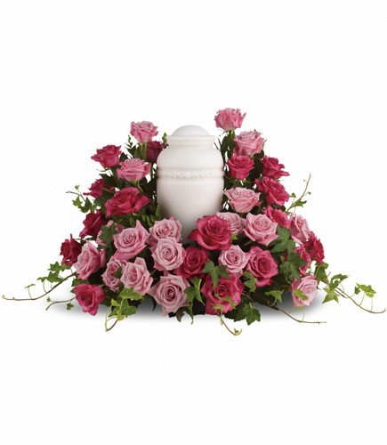A bed of mixed pink roses for the cremation urn