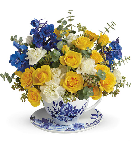 Pour on the charm! This elegant, Dutch-inspired teacup and saucer set is a pretty-meets-practical way to send a cheerful yellow and blue bouquet.