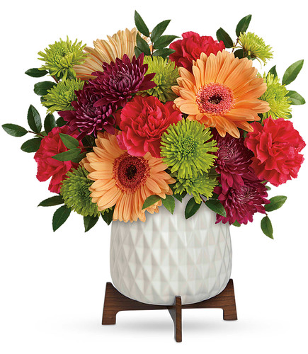 Colorful blooms in mid-mod container