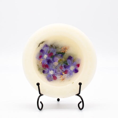Lilac Blossom Personal Space Wax Pottery Vessel 5.5 inch with Free Stand has the heady fragrance of lilac petals in full bloom, a touch of spice and a note of sun-drenched leafy greens. Individually crafted with richly fragrant wax and natural botanical accents to enjoy as a decorative home accent.  Designed to release unique fragrance without burning.