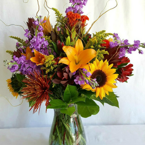 Send the Floral Fantasy Flower Bouquet featuring a fresh mix of the fall season's freshest flower blooms.