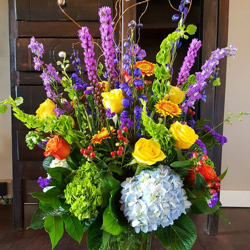 Send the Williamsburg Garden, featuring bright and beautiful roses, hydrangea, liatris, gerbera daisies, belles of Ireland and seasonal flowers.