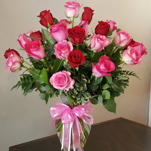 24 Pink and red  roses in clear glass vase