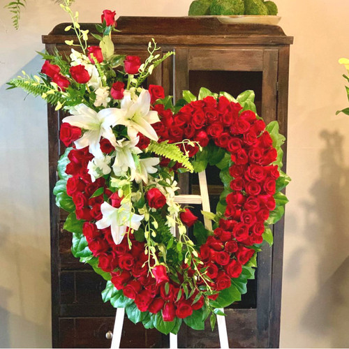 Remember your loved one at a funeral service with our Eternal Rose Sympathy Flower Collection.