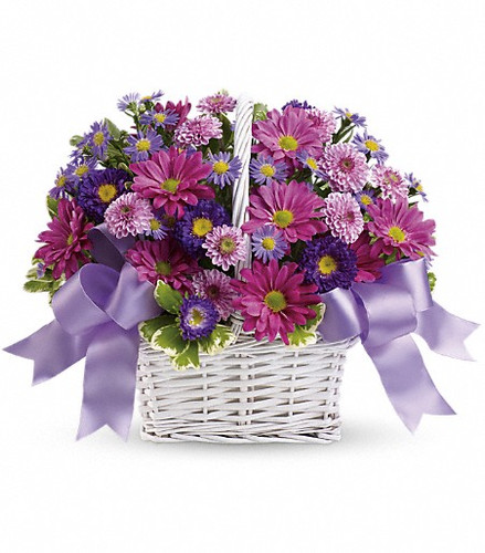 Get a handle on spring with this delightful array of floral favorites in a charming white bamboo basket accented with lavender ribbon. Surprise someone who could use a lift. It will make you both happy.