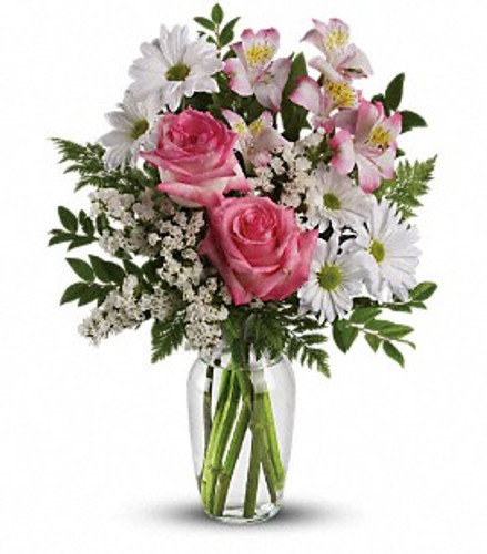 White and pink flowers in a clear glass vase.