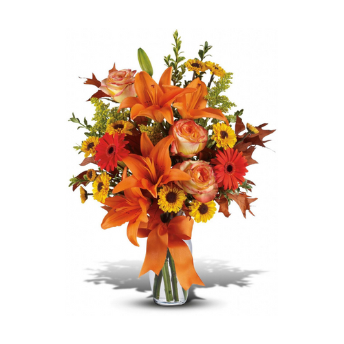 A burst of beauteous blooms in autumn shades of orange and yellow is mixed with a handful of oak leaves, then delivered in a clear glass vase adorned with a bright satin ribbon. A splendid gift for birthdays or any fall occasion.