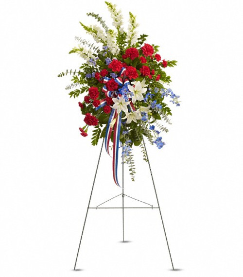 Standing tall, proud and patriotic, this dazzling free-standing spray is like a fireworks display made of graceful flowers. Uniquely beautiful, it's a lovely way to honor a great loss.
