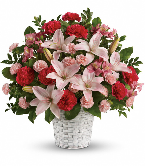 Funeral basket in white and pink blooms