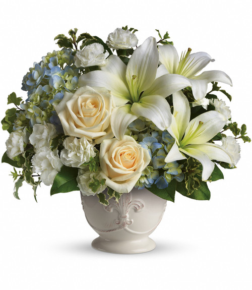 Blue hydrangea, white lilies, and white roses