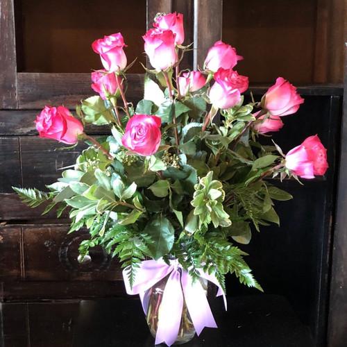 Send 12 Lavender Roses, featuring premium lavender roses designed in an elegant vase.