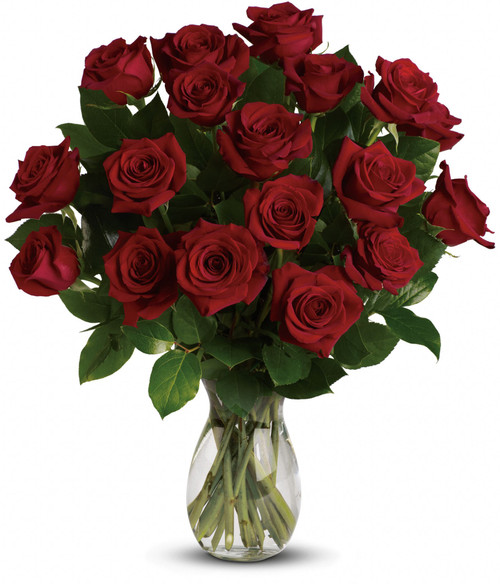 18 red roses delivered in a clear glass vase