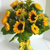 A vase of a dozen fresh sunflowers accented with solidago and matching ribbon. Send the Happy Sunflowers Bouquet, a vase of fresh sunflowers in the Williamsburg, VA area.