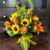 This arrangement radiates as bright as the sun. It's hand-designed with sunflowers, roses, gerbera daisies, tiger lilies and belles of Ireland.