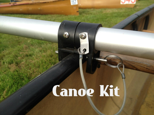 "Canoe Mount. 2 Canoe brackets are slid over cross tube and set with screws. A 1/4"" fast pins is used to mount the cross tube to the hull. A mast foot is glued to the bottom of canoe."