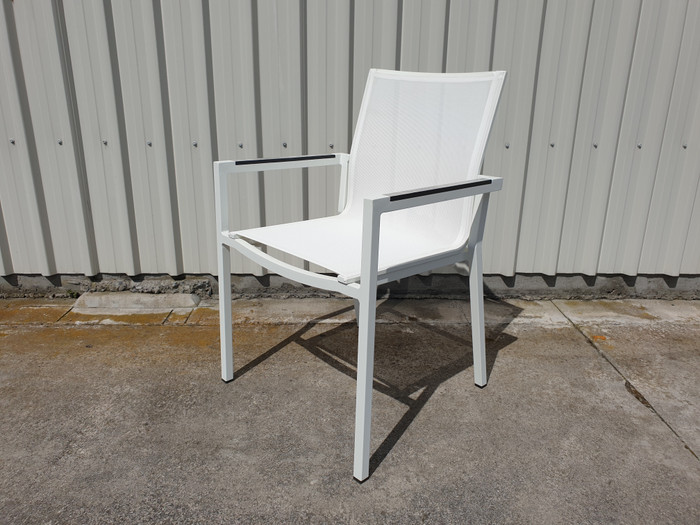 View of Amaka dining arm chair in white, with High Pressure Laminate armrests