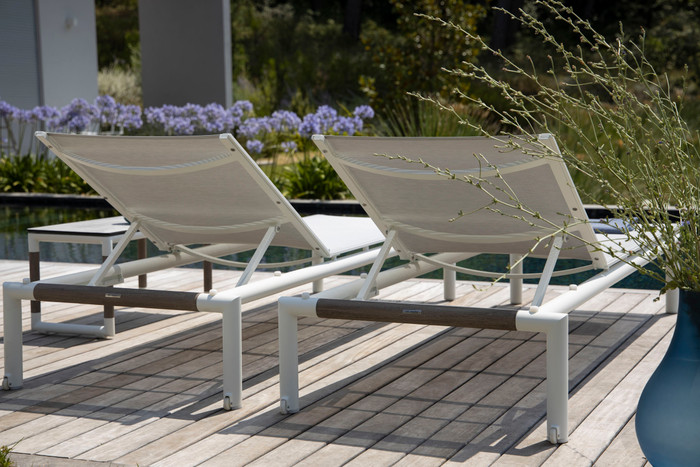 Rear view of Bastingage batyline Eden mesh and aluminium frame sun lounger by les Jardins with teak accent