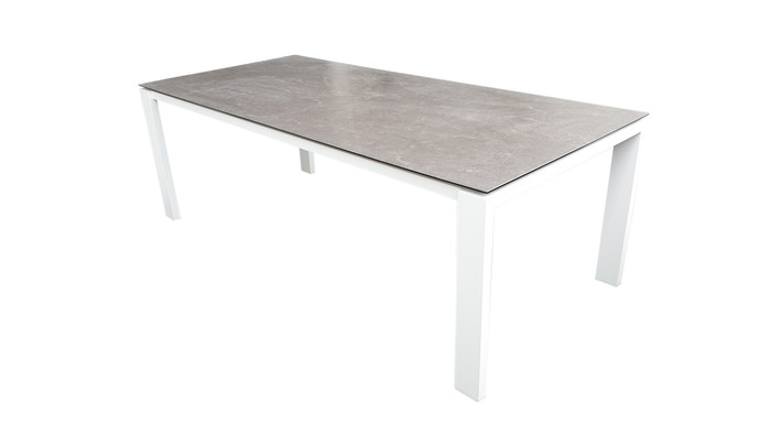 Poly Ceramic top and aluminium frame outdoor dining table in 2 colour ways. Size 220x100 shown as reference to design only. Table shown is white frame with dark grey ceramic top.