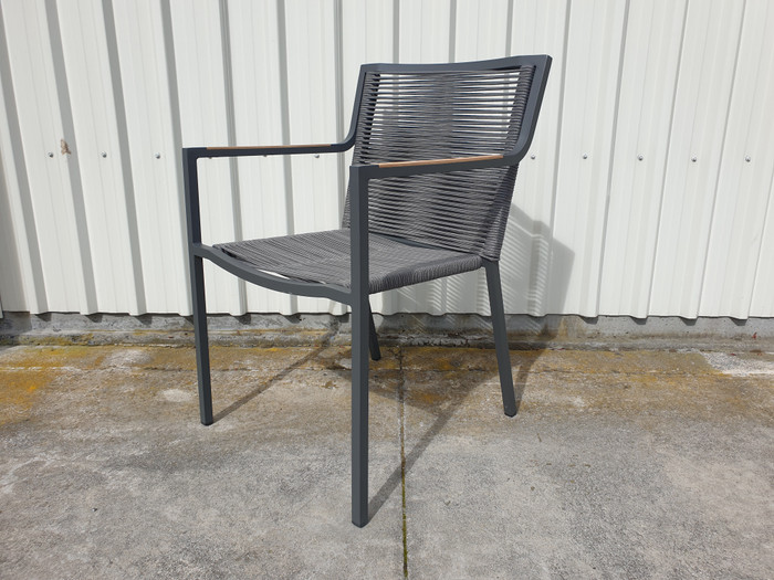 Angled view of Ribbon dining arm chair in grey colour