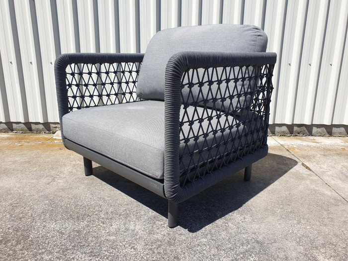 Angle view of Club outdoor lounge chair by Couture Jardin in dark grey rope and fabric.