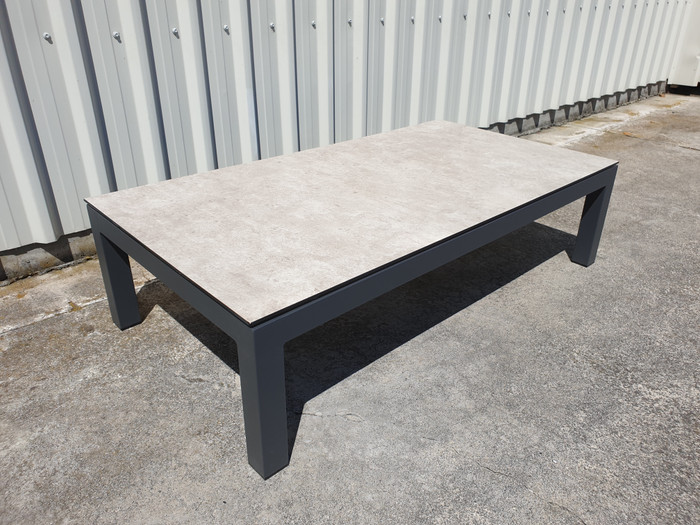 Lisbon outdoor coffee table with Lava powder-coated aluminium frame and glass top, finished in a faux concrete beton look.
