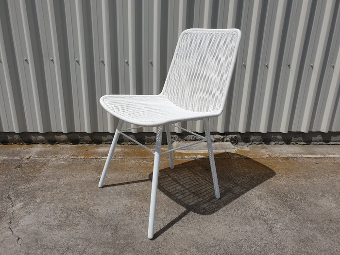 Angle view of Sam outdoor wicker side chair