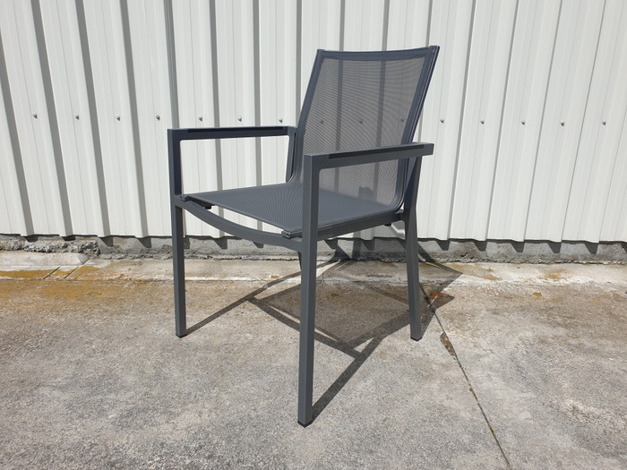 View of Amaka dining arm chair in slate grey, with High Pressure Laminate armrests