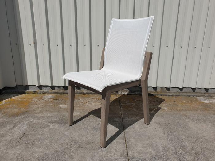 Copenhague outdoor dining  side chair by Les Jardins. Teak wood is finished in Duratek coating.  Batyline Eden sling seat.
