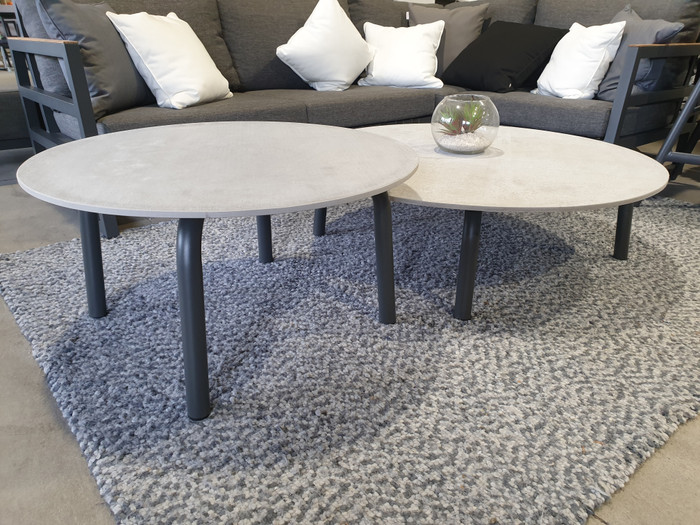 Image shows the small Cleo table (taller) and the large Cleo table (lower) nestled together