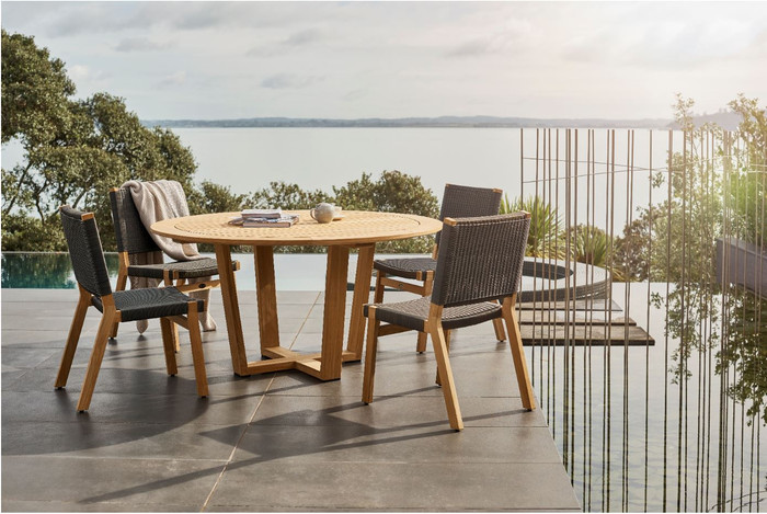 Devon Pegasus outdoor teak round table 1.5m diameter, shown with Jackson side chairs in shadow grey