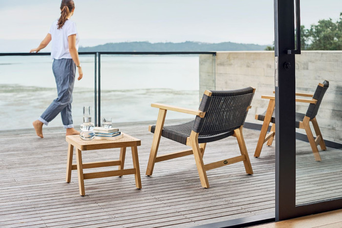 Devon Jackson outdoor easy chair in shadow grey wicker. Picture also shows Devon Omaha side table.