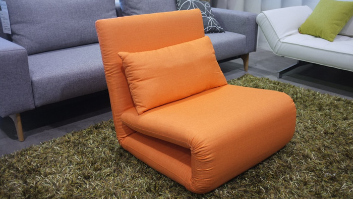 Last tri-fold sofa bed. Only in orange with a blue lumbar cushion