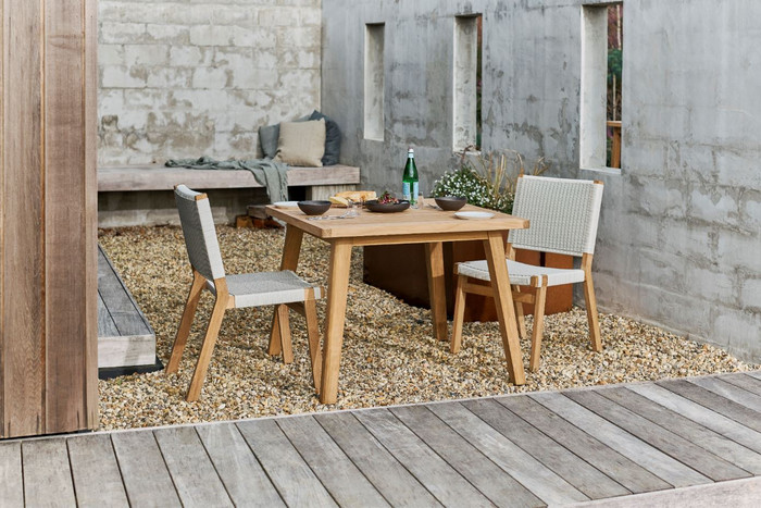 Devon Jackson outdoor teak dining side chairs in whitewash shown with matching Porter outdoor square teak table.