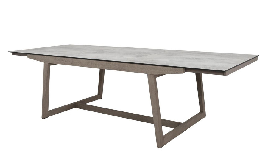 Les Jardins outdoor teak table with HPL top - showing extension leaf inserted and table fully extended