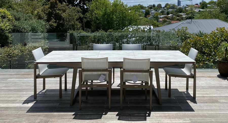 Skaal outdoor dining table and matching Skaal chairs in situ in Auckland