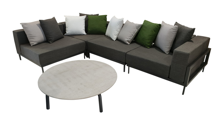 Alternate view of Cleo Alu modular outdoor sofa set comprising 2 x corner sofas and 2 x single sofas. Picture also shows scatter cushions available separately and a cleo concrete top coffee table