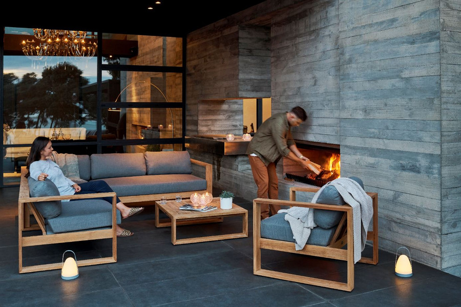 Ambient shot of Milford outdoor teak corner sofa set, with milford lounge chair