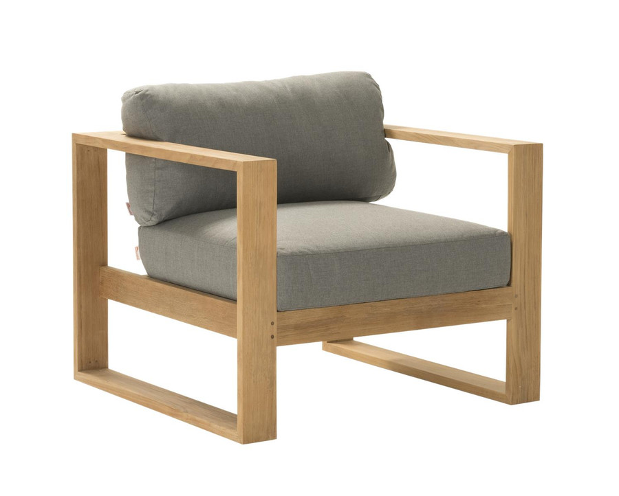 Angle view of Devon Milford outdoor teak lounge chair