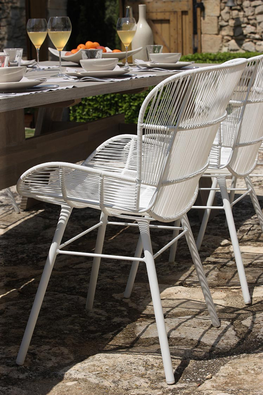 Ambient image of Rose outdoor dining arm chair in white