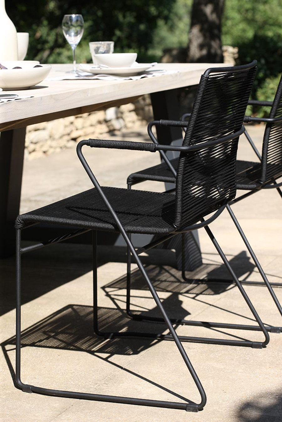 James outdoor dining arm chair in Lava Rope used with the Beach dining table