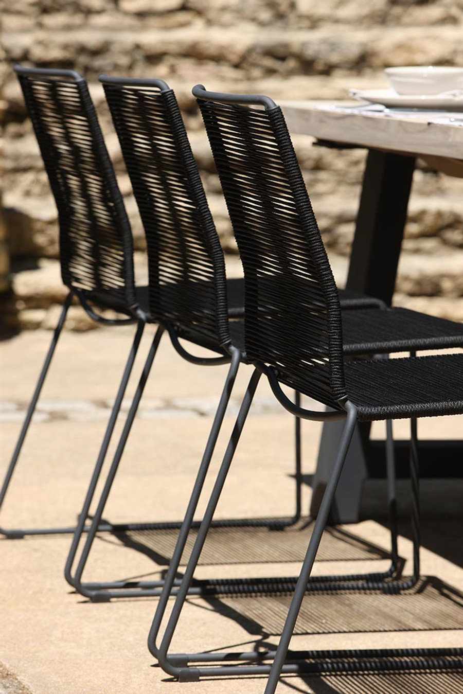 James outdoor dining side chair in Lava Rope used with the Beach dining table