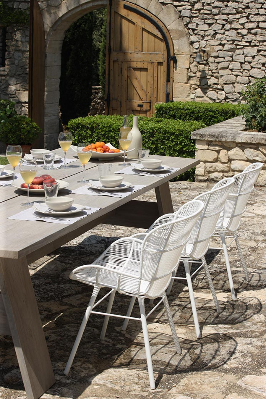 Ambient image of Vista table with Rose outdoor dining arm chairs